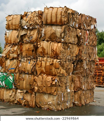 stack of paper waste before shredding at recycling plant in Germany
