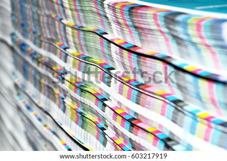 Stack of paper with CMYK scale