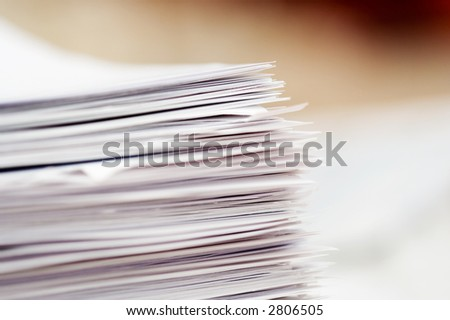 Stack of papers, focus in corner of stack