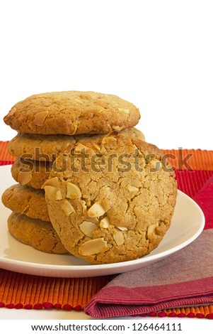 Stack of peanut butter biscuits with almond topping