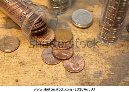 Stack of pennies in coin counter with other coins