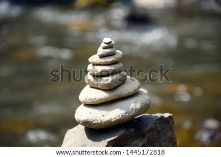 Stack of perfectly balanced, round stones. Symbolising Zen: A focused, peaceful and quiet mind. Shot on the island of Bali - Indonesia