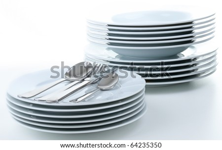 stack of plate and cutlery on white background
