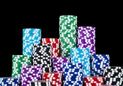 Stack of Poker chips isolated on a black background. poker table. Poker game concept. Playing a game with dice. Casino Concept for business risk, chance, good luck or gambling. chips for poker game
