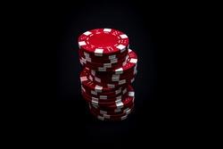 Stack of poker chips on black background