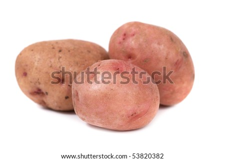Stack of potatoes isolated on white background