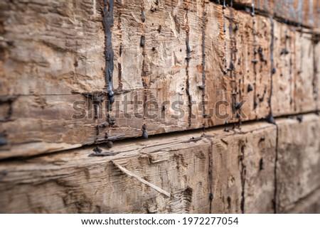 Stack of railway beams, track underlays, old wooden balks,  wood tar brown. Stockfoto ©