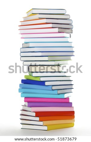 Stack of rainbow colored real books in spiral formation, side view, isolated on white background