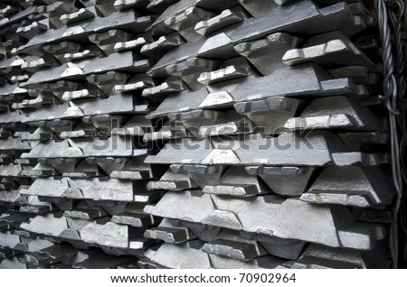 Stack of raw aluminum ingots in aluminum profiles factory