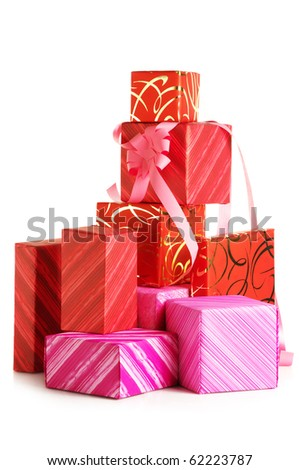 Stack of red and pink gifts isolated on white background.