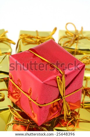 stack of red nad golden gifts isolated on white
