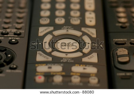 stack of remotes - stock photo
