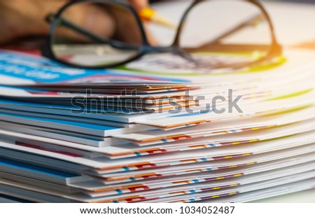 Stack of report paper documents for business desk with glasses, Business papers for Annual Reports files, Document is written,presented. Business offices concept, soft focus
