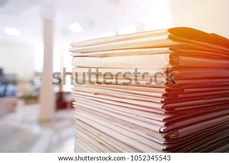 Stack of report paper documents in office #1052345543
