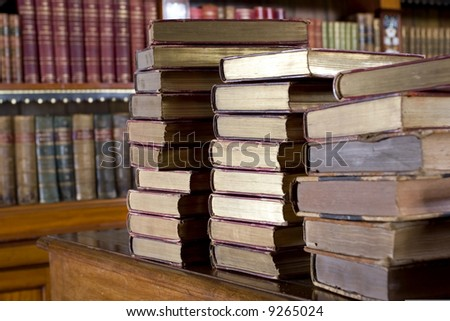 Stack of retro books on the table in reading room