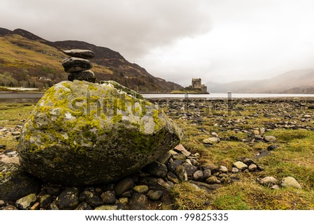 Stack of rocks in front of Eilean Donan Castle