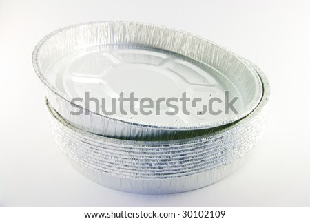 stack of round high sided catering trays