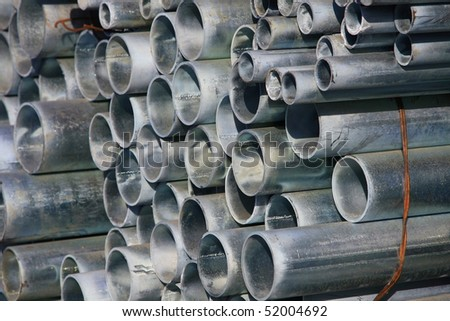stack of rounded steel pipes