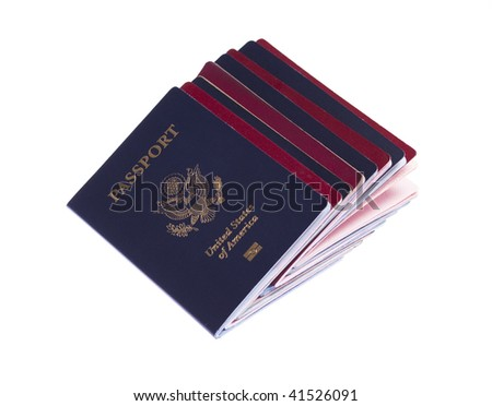 Stack of russian and US passports on white isolated