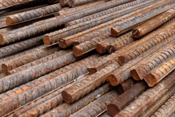 Stack of rusty iron rods or bars