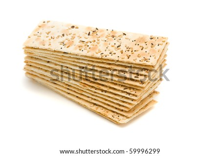 Stack of sesame crackers over white background
