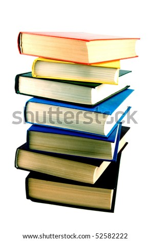 stack of seven colored closed books isolated on white