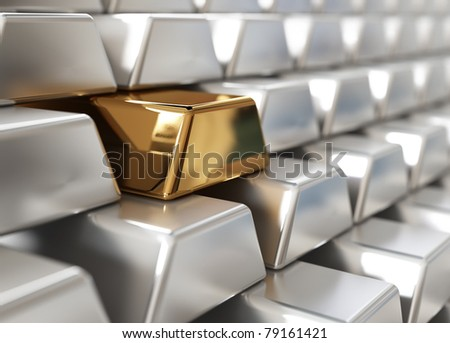 Stack of silver ingots with one golden