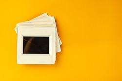stack of slides lies on a yellow background. Design element.