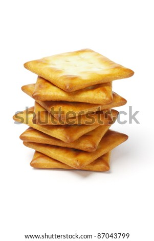 Stack of square shape crackers on white background