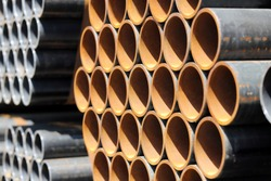 Stack of steel pipes industrial background