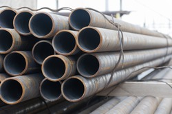 Stack of steel pipes on warehouse