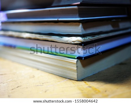 stack of student textbooks and notebooks
