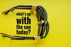 Stack of 3 sunglasses bound with the yellow tape, for watching sun eclipse. Text what's up with the sun today