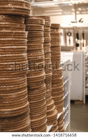 Stack of supports for hot dishes made of cork material. Recycling of materials. Eco-friendly packaging. Cardboard box #1418716658