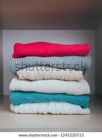 Stack of sweaters. Winter is coming #1245220513