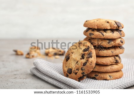Stack of tasty chocolate cookies on gray table Stock photo ©