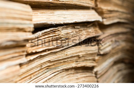 Stack of the old paper documents in the archive.