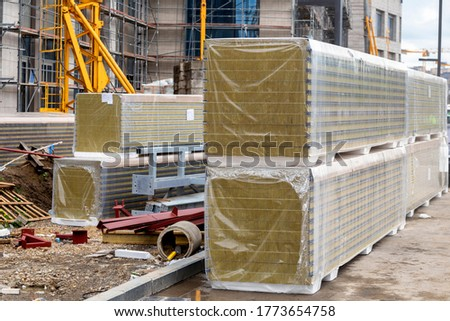 Stack of thermal insulation sandwich panels at the construction site. Fiber material for warming the walls of the building.