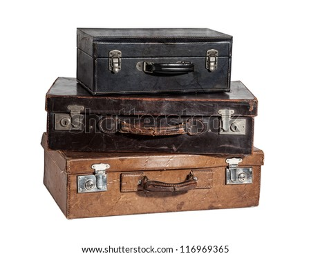 stack of three antique suitcases isolated on white