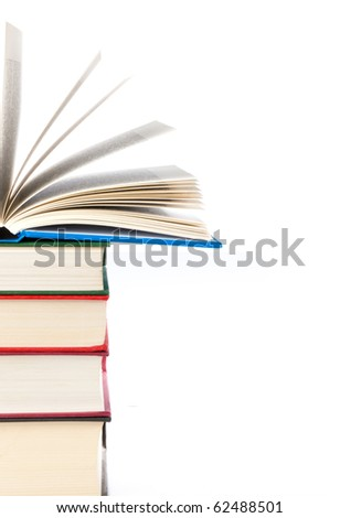Stack of three books with a fourth open lying on top