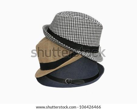 Stack of three fedora hats isolated on white background