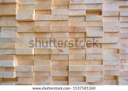 Stack of three-layer wooden glued laminated timber beams from pine finger joint spliced boards #1537581260
