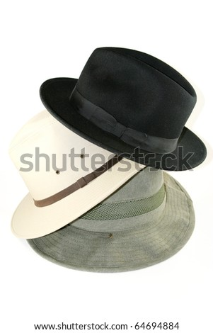 Stack of three mens hats isolated on white background
