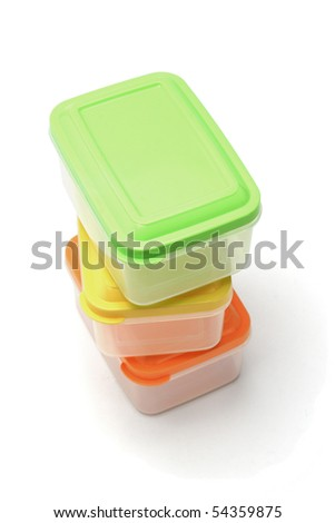 Stack of three plastic storage boxes on white background