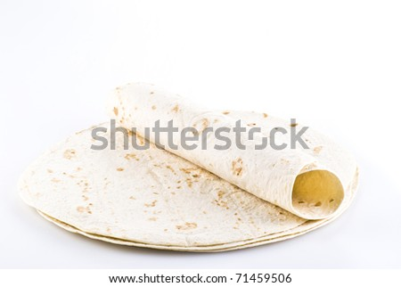 Stack of tortillas with one on the top - isolated