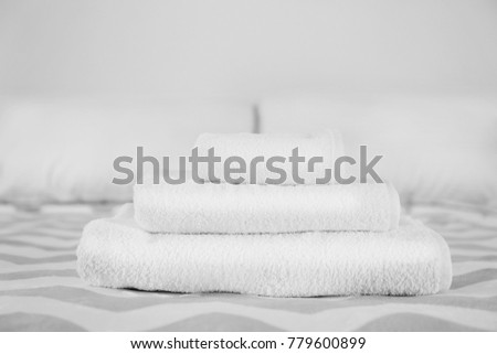 Stack of towels on bed #779600899