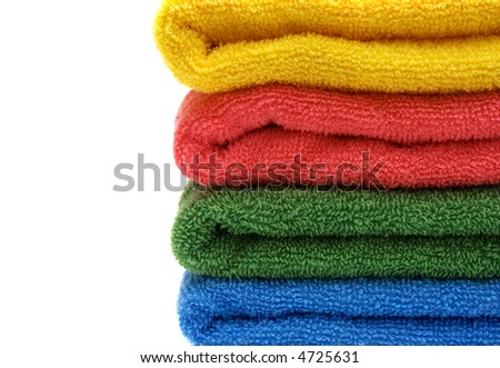 stack of towels on white background with copyspace