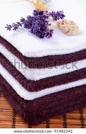Stack of towels with lavender
