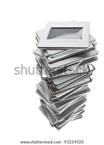 Stack of transparency photo slides over white background