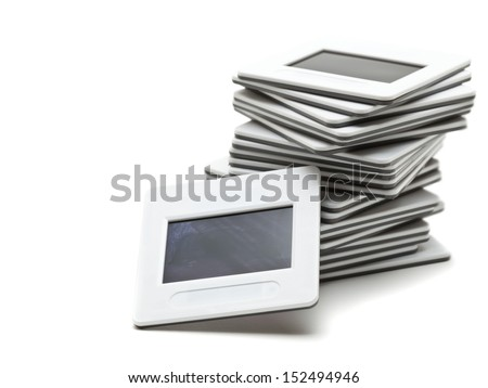 Stack of transparency slides over white background
